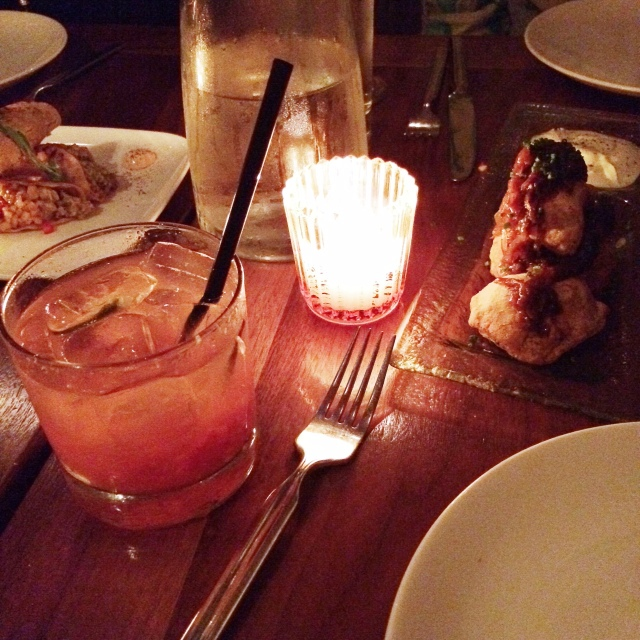 Strawberry Fields Cocktail with pierogies to the right